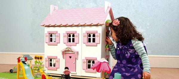 Лялькові будиночки в інтер'єрі кімнати для дівчаток — розвиваюча іграшка і прикраса покоїв принцеси